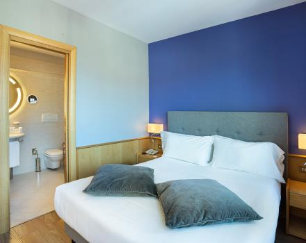 Welcome and comfort in the triple rooms of our hotel in central Turin